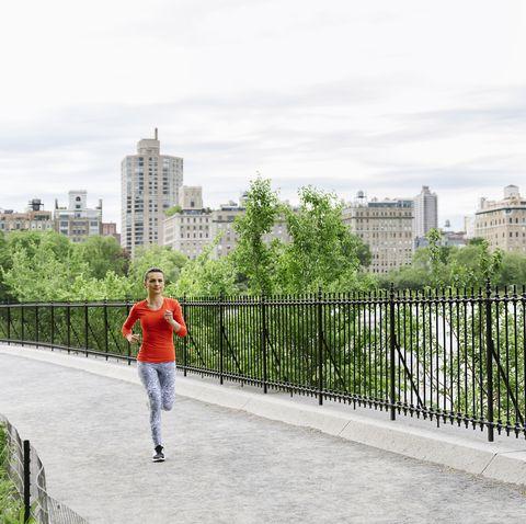 Beautiful young woman running.