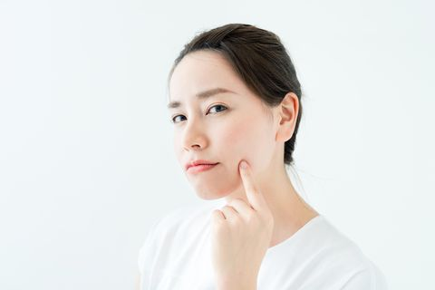 beauty asian girl who checks her skin skin care acne treatment