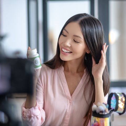 beauty blogger feeling satisfied after taking hair growth vitamins