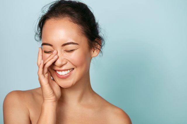 beauty face smiling asian woman touching healthy skin portrait