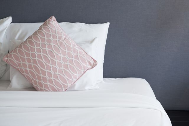 close up of bed with white sheets