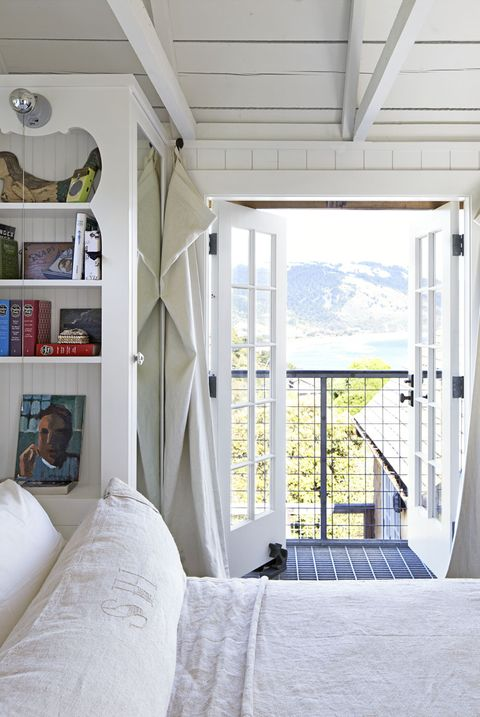 white bedroom with sea view