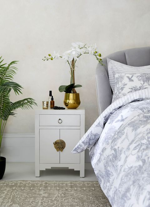orchid plant on bedside table