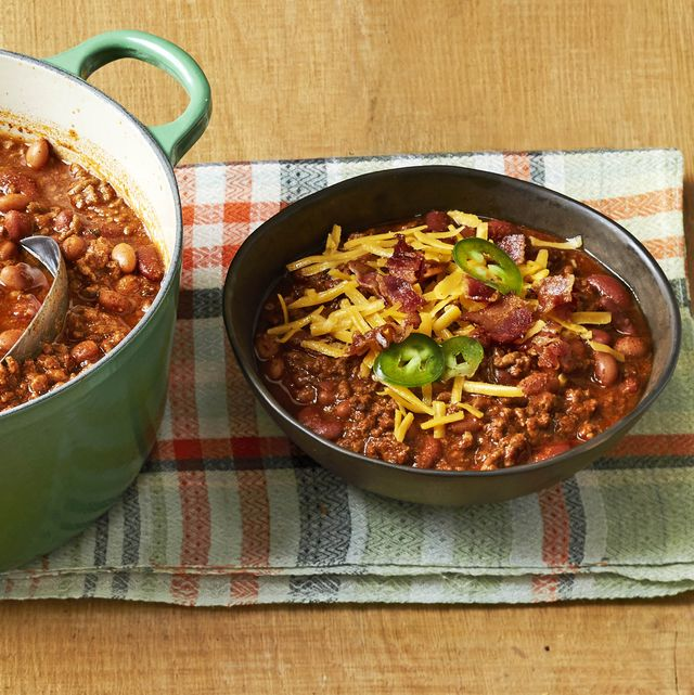 beef and bean chili with shredded cheese and jalapeno