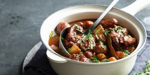 Beef bourguignon in pan with ladle
