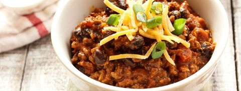 Beef chili with kidney beans and cheese topping