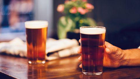 pint of beer in hand