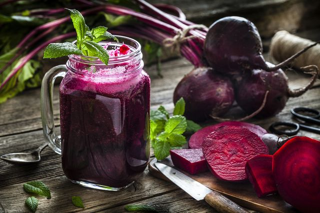 healthy drink beet juice on rustic wooden table