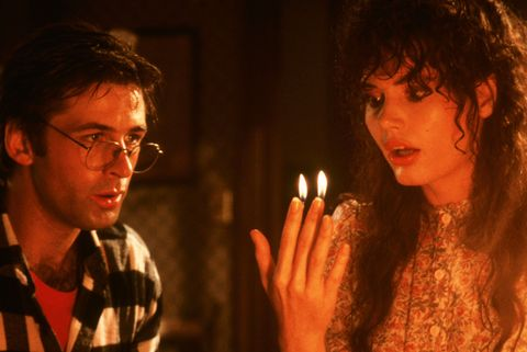a still from beetlejuice, whereby actresses fingertips have sparked flames