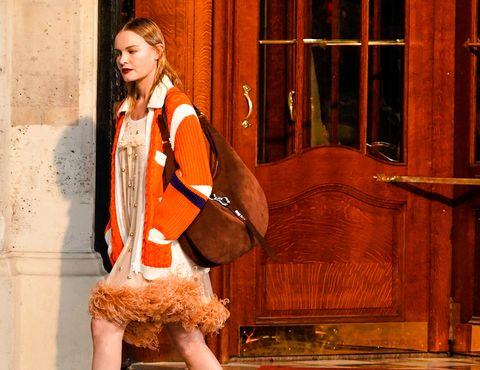 Orange, Fashion, Outerwear, Acting, Long hair, Jacket, Performance,