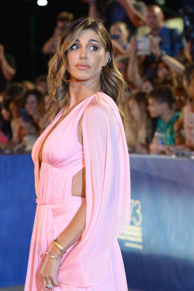argentinian model belen rodriguez poses on the red carpet before the premiere of arrival presented in competition at the 73rd venice film festival on september 1, 2016 at venice lido  afp  filippo monteforte        photo credit should read filippo monteforteafp via getty images