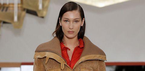 Face, Fashion, Lip, Human, Fashion design, Outerwear, Brown hair,