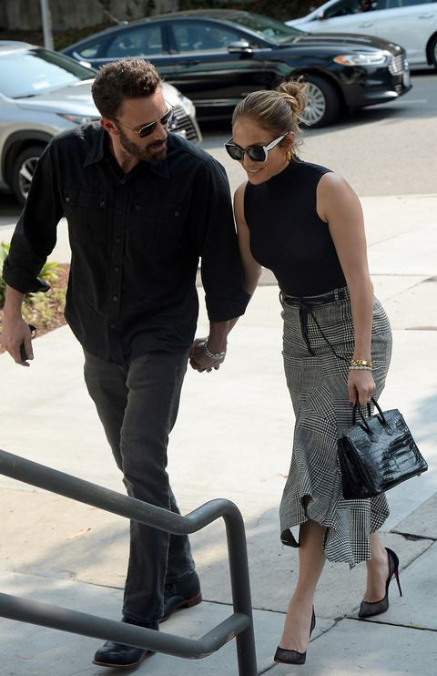 ben affleck and jennifer lopez, she with prince of wales plaid skirt and black sleeveless top