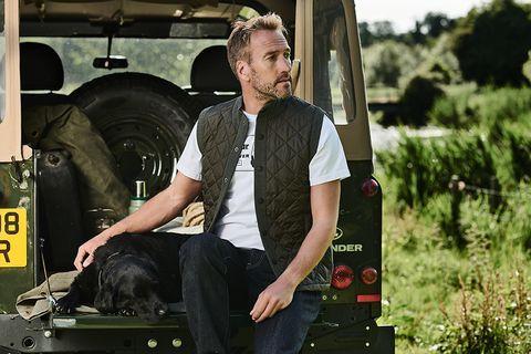 Ben Fogle and dog in Land Rover Defender - Barbour