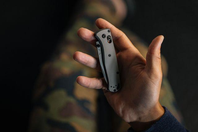 a hand holding a folding pocket knife