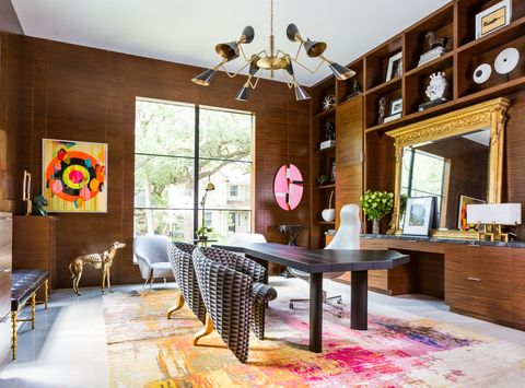 a bookcase and office space designed by benjamin johnston, with many memphis design elements