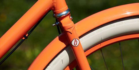 Bicycle part, Bicycle wheel, Bicycle, Bicycle tire, Bicycle frame, Orange, Bicycle handlebar, Vehicle, Bicycle fork, Road bicycle,
