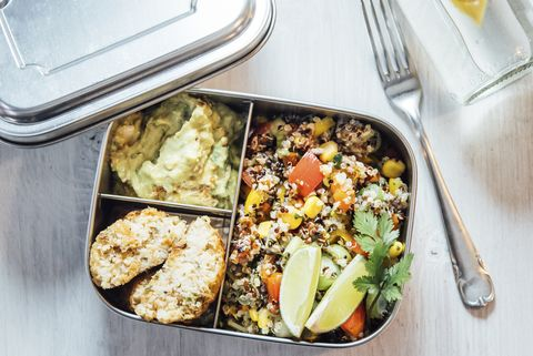 bento box of quinoa salad with vegetables and lime, avocado cream and cauliflower dumplings