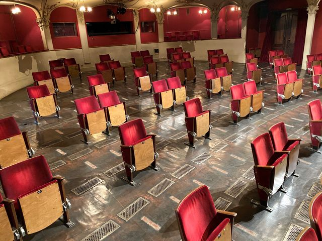theater with spaced seating