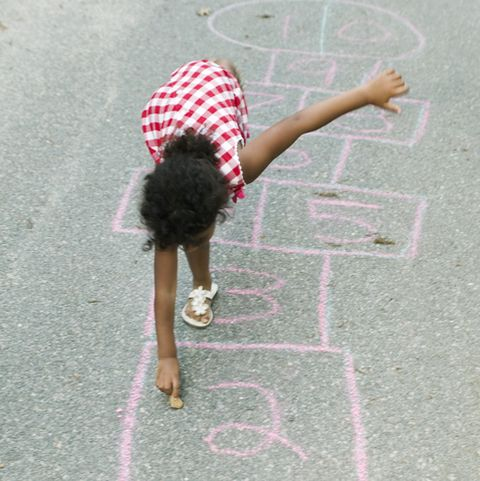 black girl playing hopscotch