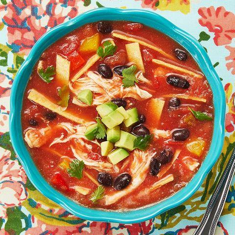 chicken tortilla soup in blue bowl