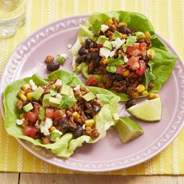turkey taco lettuce wraps on pink plate