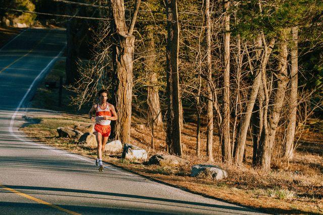 tracksmith man running on side of road