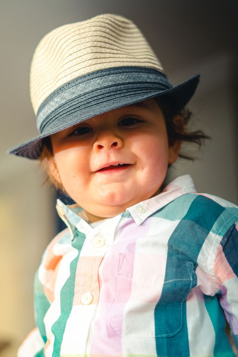 Child, Hat, Clothing, Skin, Toddler, Sun hat, Cheek, Fashion accessory, Headgear, Smile,