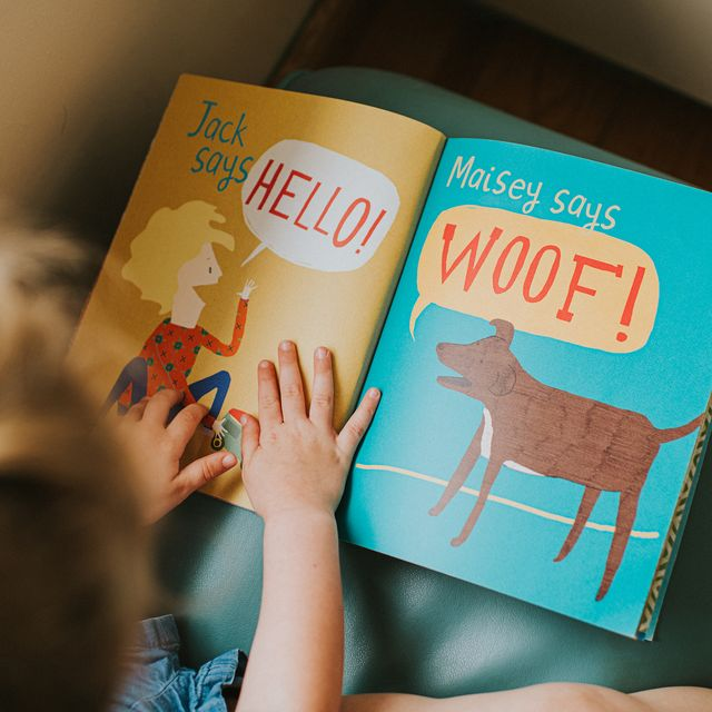 little girl reading a simple picture book