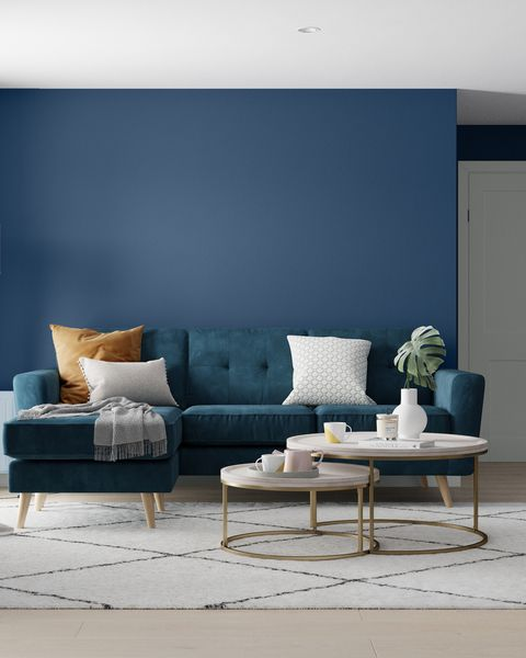 living room with dark navy wall in sapphire salute from dulux