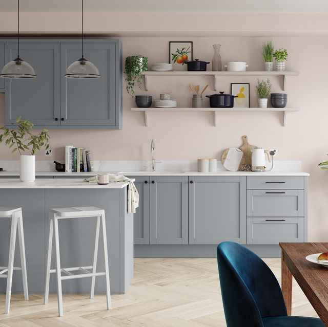 grey kitchen with pink walls