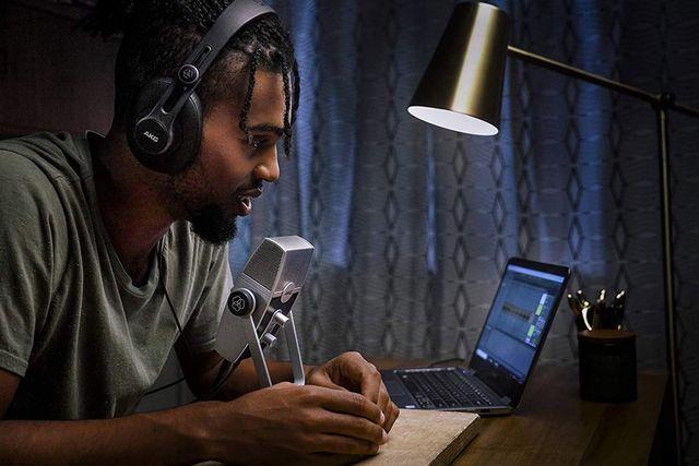 man using akg pro audio lyra ultrahd