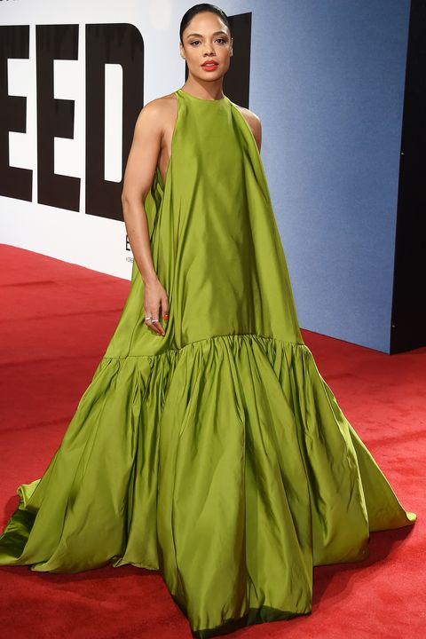 Fashion model, Red carpet, Clothing, Carpet, Fashion, Dress, Green, Shoulder, Gown, Flooring,