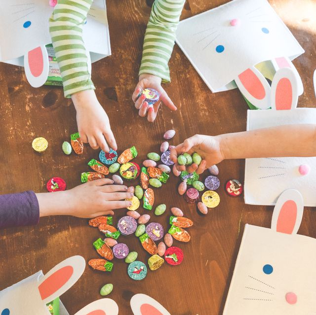 kids reaching for candy on table with bunny bags