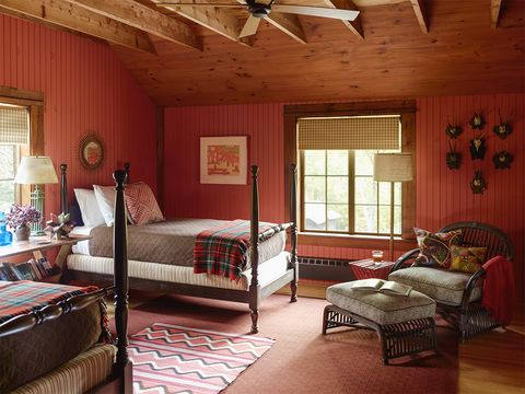 boston architect heather wells's cabin retreat in north sutton, new hampshire in a guest bedroom, the wicker chair and ottoman have cushions covered in an alan campbell fabric, the antique beds are dressed in utility canvas coverlets, and a vintage navajo rug is layered over a carpet by kasthall the pine walls are painted in benjamin moore's golden gate  for details, see resources  elle decor, december 2016