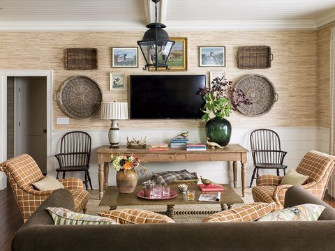 pumpkin grasscloth and chairs in a pretty sitting room