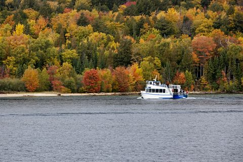 Water transportation, Water, Tree, Boat, River, Autumn, Vehicle, Waterway, Leaf, Loch,