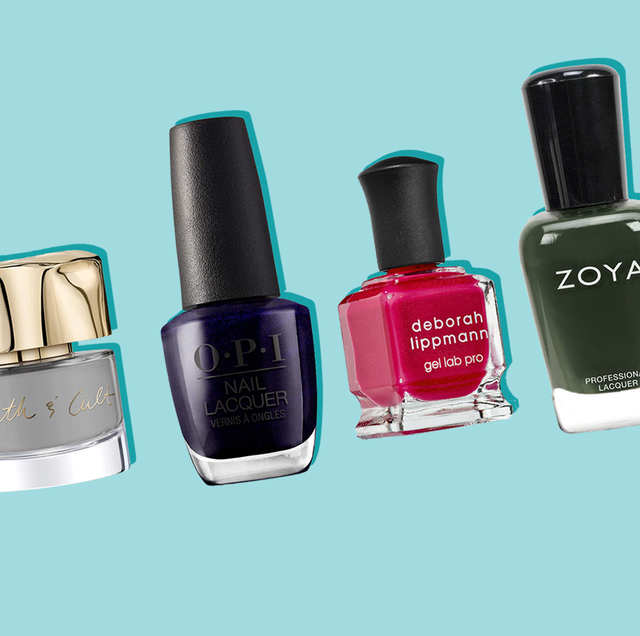 various fall nail color shades on blue background