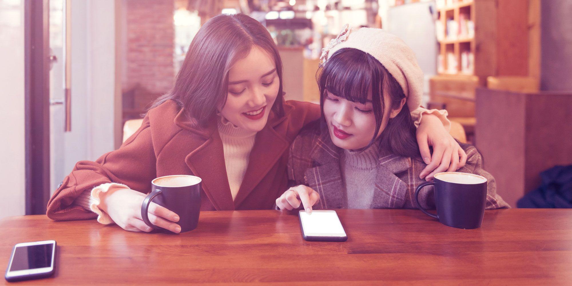 Two women drinking coffee