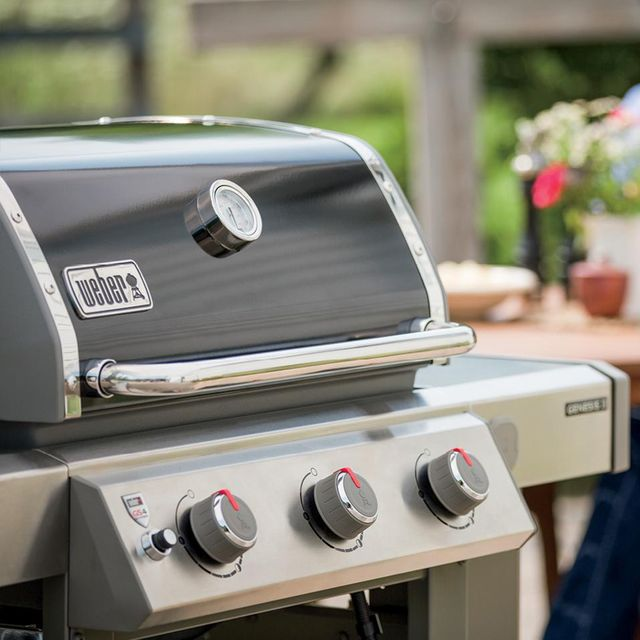 weber gas grill next to steak on grill