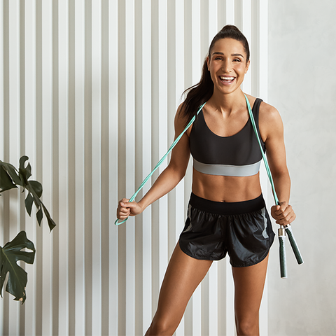 kayla itsines laughing in a white room