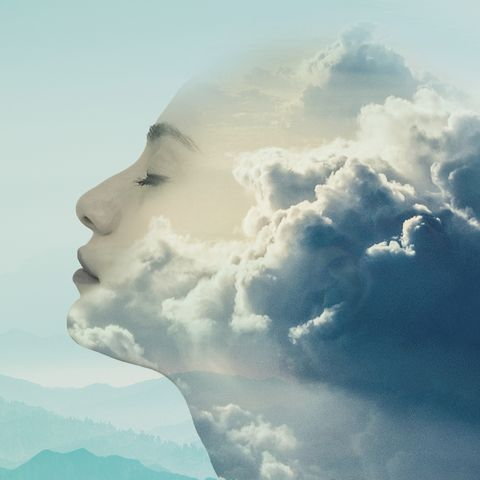 woman's face merging with clouds