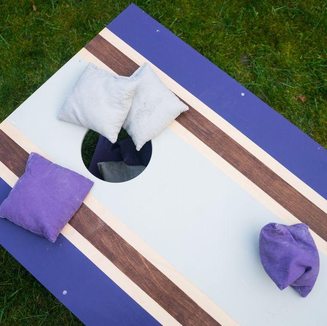 purple diy cornhole board with bean bags