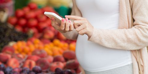 Hand, Finger, Natural foods, Fruit, Plant, Food, Gesture, Nail, Play,