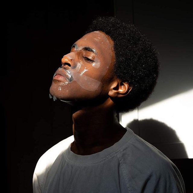 man wearing bro face mask
