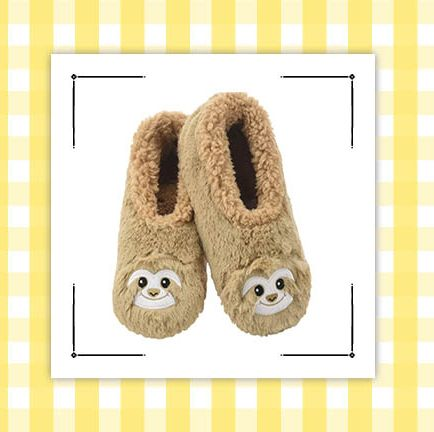 sloth slippers and sloth plant ornament on pot with plant in it on yellow and white gingham background