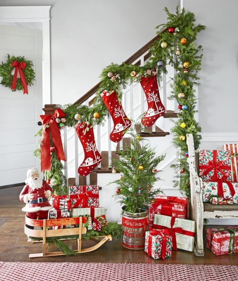 vintage inspired christmas banister decorations like shiny brite ornaments and stockings