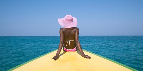 Pink, Fun, Vacation, Sun tanning, Summer, Sea, Sitting, Leisure, Physical fitness, Headgear,