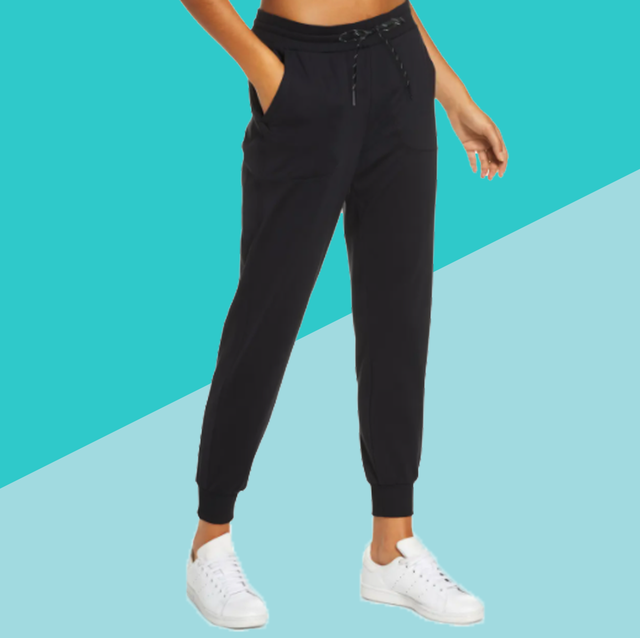 woman in sweatpants on blue background