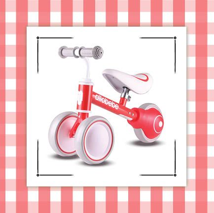 best toy gifts for christmas with pink and red tricycle and nerf gun